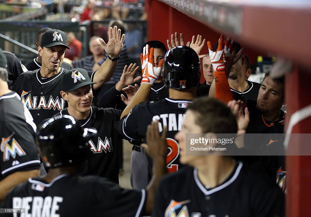 <a gi-track='captionPersonalityLinkClicked' href=/galleries/search?phrase=Giancarlo+Stanton&family=editorial&specificpeople=8983978 ng-click='$event.stopPropagation()'>Giancarlo Stanton</a> #27 of the Miami Marlins is congratulated by teammates in the dugout after hitting a two-run home run against the Arizona Diamondbacks during the sixth inning of the MLB game at Chase Field on June 17, 2013 in Phoenix, Arizona.
