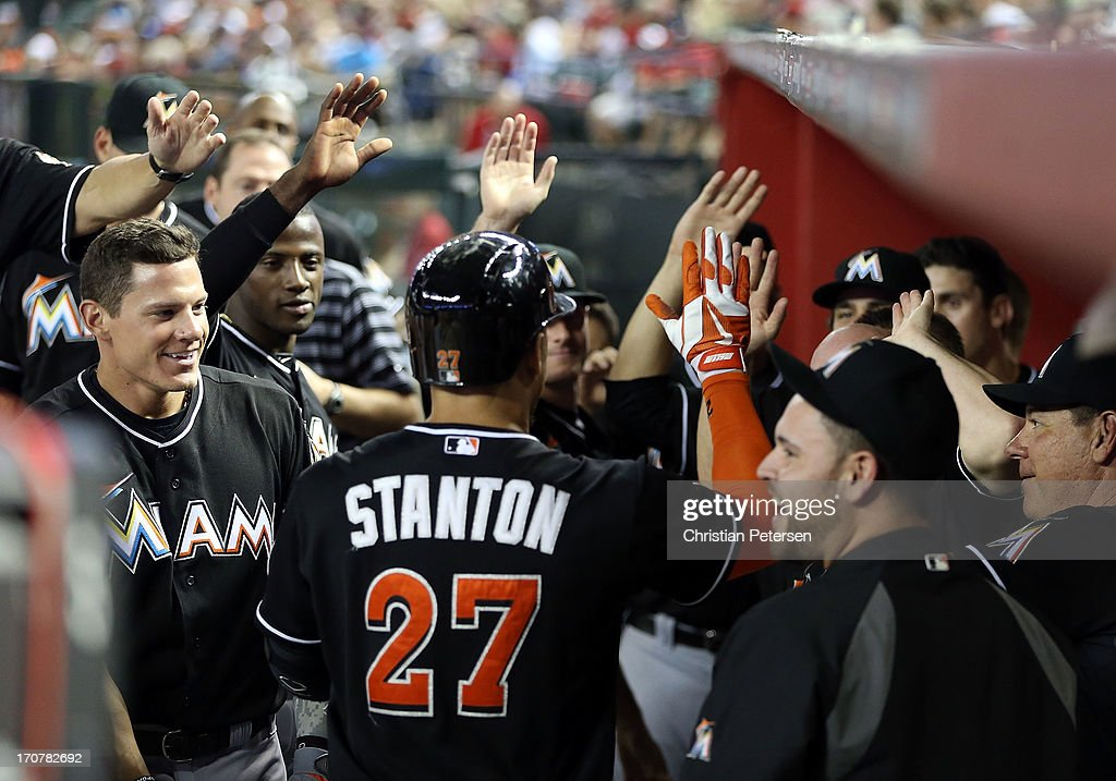 <a gi-track='captionPersonalityLinkClicked' href=/galleries/search?phrase=Giancarlo+Stanton&family=editorial&specificpeople=8983978 ng-click='$event.stopPropagation()'>Giancarlo Stanton</a> #27 of the Miami Marlins is congratulated by teammates in the dugout after hitting a solo home run against the Arizona Diamondbacks during the ninth inning of the MLB game at Chase Field on June 17, 2013 in Phoenix, Arizona. The Marlins defeated the Diamondbacks 3-2.