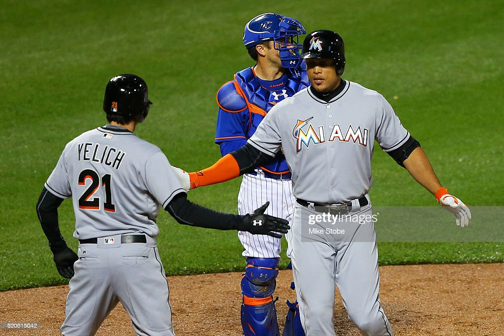 Giancarlo Stanton of the Miami Marlins is greeted by Christian Yelich after connecting on a tworun home run in the second inning against the New York...