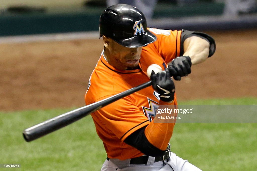 Giancarlo Stanton #27 of the Miami Marlins is hit by a pitch from Mike Fiers of the Milwaukee Brewers during the top of the fifth inning at Miller Park on September 11, 2014 in Milwaukee, Wisconsin.