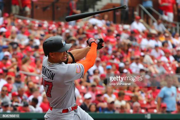 Giancarlo Stanton of the Miami Marlins loos his bat while swing for the ball against the St Louis Cardinals in the first inning at Busch Stadium on...