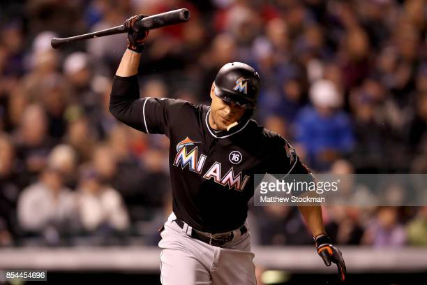 Giancarlo Stanton of the Miami Marlins reacts to flying out in the sixth inning against the Colorado Rockies at Coors Field on September 26 2017 in...