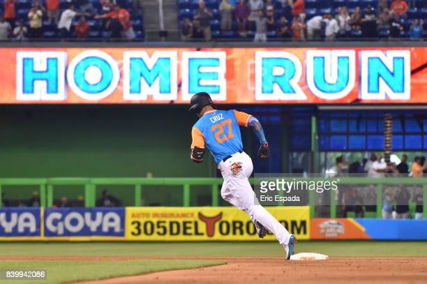 Giancarlo Stanton of the Miami Marlins rounds second base after hitting his 50th home run of the season in the eighth inning against the San Diego...
