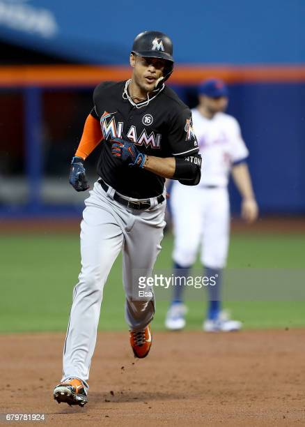 Giancarlo Stanton of the Miami Marlins rounds the bases after his solo home run in the second inning against the New York Mets on May 6 2017 at Citi...