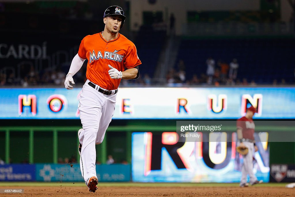 <a gi-track='captionPersonalityLinkClicked' href=/galleries/search?phrase=Giancarlo+Stanton&family=editorial&specificpeople=8983978 ng-click='$event.stopPropagation()'>Giancarlo Stanton</a> #27 of the Miami Marlins rounds the bases after hitting a three run home run during the first inning of the game against the Arizona Diamondbacks at Marlins Park on August 17, 2014 in Miami, Florida.