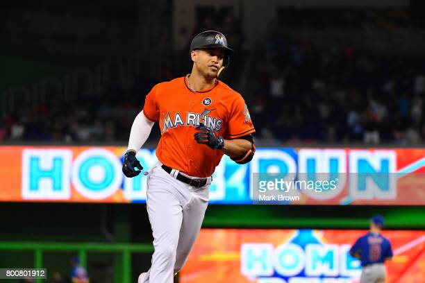 Giancarlo Stanton of the Miami Marlins rounds the bases after hitting a home run in the seventh inning during the game between the Miami Marlins and...