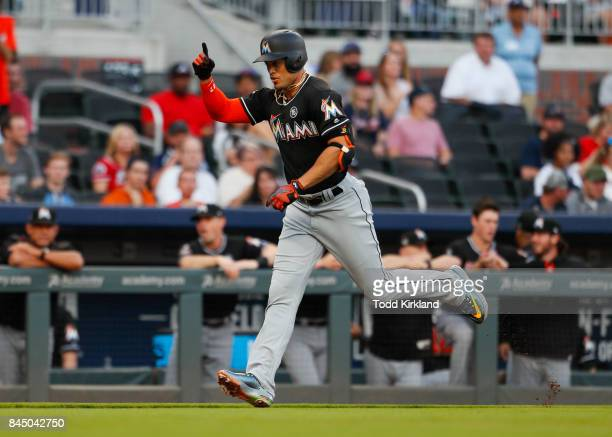 Giancarlo Stanton of the Miami Marlins rounds third after hitting a solo home run in an MLB game against the Atlanta Braves at SunTrust Park on...