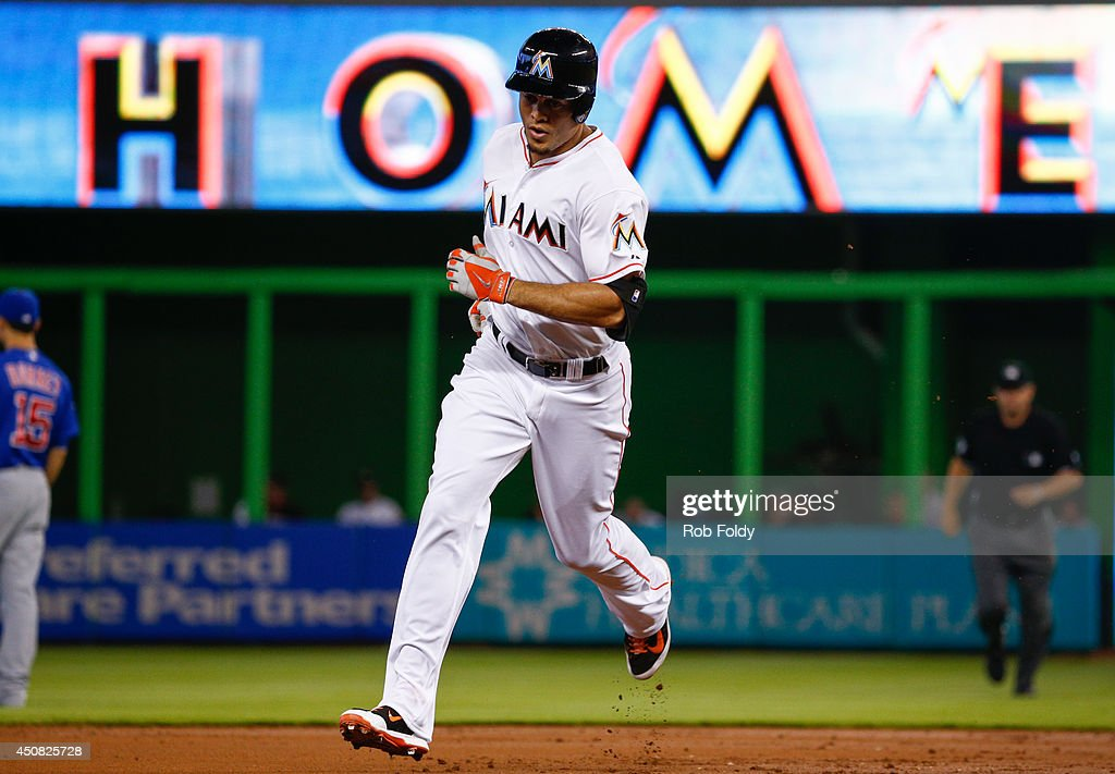 <a gi-track='captionPersonalityLinkClicked' href=/galleries/search?phrase=Giancarlo+Stanton&family=editorial&specificpeople=8983978 ng-click='$event.stopPropagation()'>Giancarlo Stanton</a> #27 of the Miami Marlins runs the bases after hitting a home run during the first inning of the game against the Chicago Cubs at Marlins Park on June 18, 2014 in Miami, Florida.