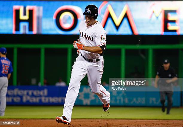 Giancarlo Stanton of the Miami Marlins runs the bases after hitting a home run during the first inning of the game against the Chicago Cubs at...