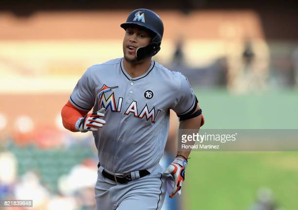 Giancarlo Stanton of the Miami Marlins runs the bases after hitting a tworun home run against the Texas Rangers in the first inning at Globe Life...