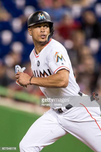 Giancarlo Stanton of the Miami Marlins runs to second base during a MLB game against the Washington Nationals at Marlins Park on August 1 2017 in...