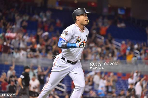 Giancarlo Stanton of the Miami Marlins runs towards first base after hitting a home run in the first inningagainst the San Francisco Giants at...