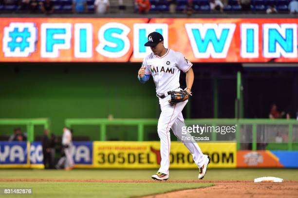 Giancarlo Stanton of the Miami Marlins runs towards the infield after they defeated the San Francisco Giants at Marlins Park on August 14 2017 in...