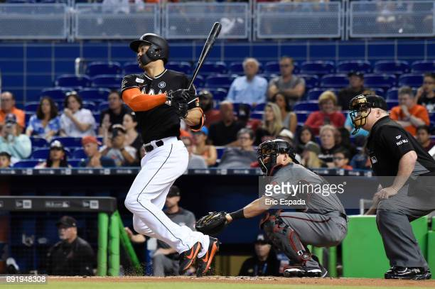 Giancarlo Stanton of the Miami Marlins singles in the first inning against the Arizona Diamondbacks at Marlins Park on June 3 2017 in Miami Florida