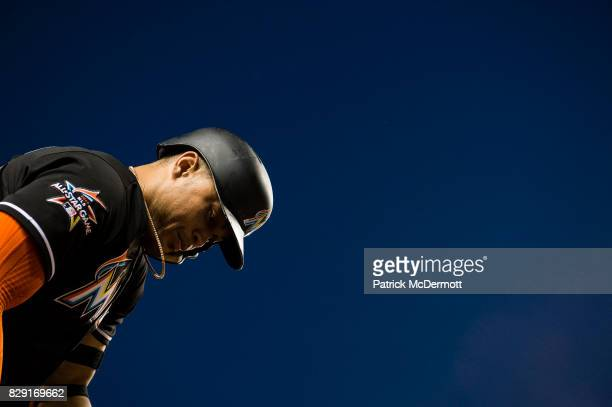 Giancarlo Stanton of the Miami Marlins stands out deck in the fifth inning during a game against the Washington Nationals at Nationals Park on August...