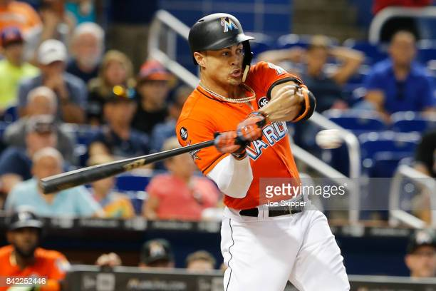 Giancarlo Stanton of the Miami Marlins swings and strikes out in the first inning against the Philadelphia Phillies at Marlins Park on September 3...