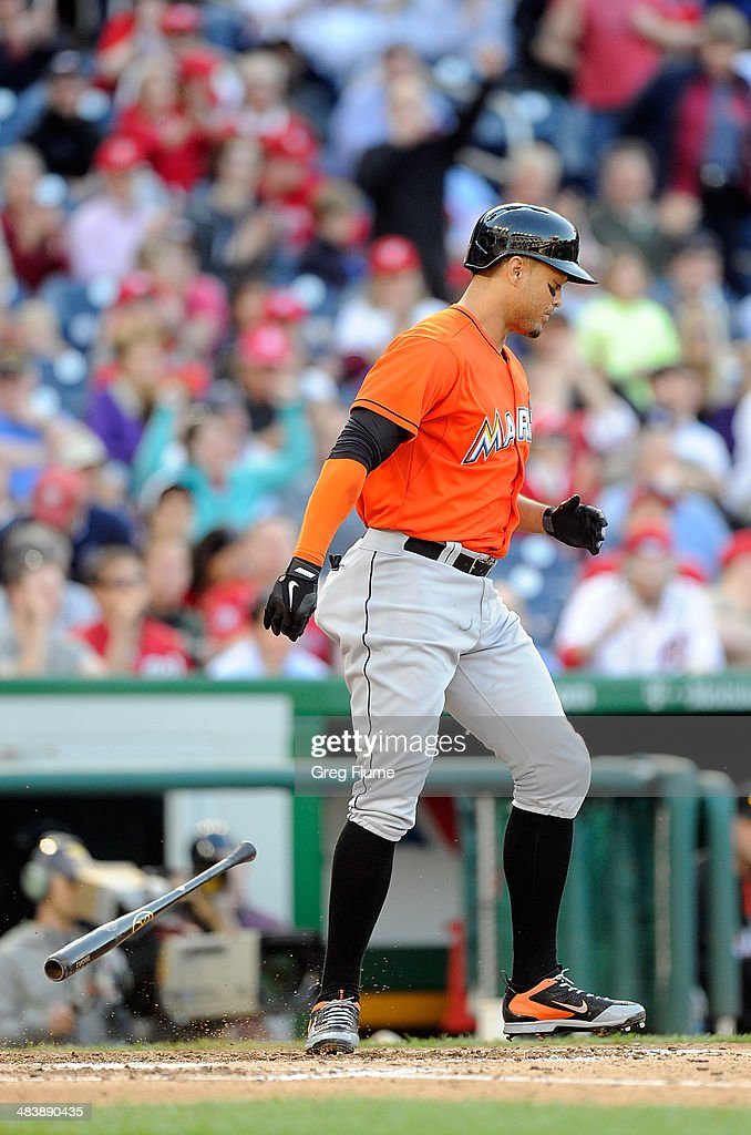 <a gi-track='captionPersonalityLinkClicked' href=/galleries/search?phrase=Giancarlo+Stanton&family=editorial&specificpeople=8983978 ng-click='$event.stopPropagation()'>Giancarlo Stanton</a> #27 of the Miami Marlins throws his bat after striking out to end the eighth inning against the Washington Nationals at Nationals Park on April 10, 2014 in Washington, DC.