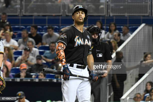 Giancarlo Stanton of the Miami Marlins walks back to the dugout after striking out in the 7th inning against the Pittsburgh Pirates at Marlins Park...