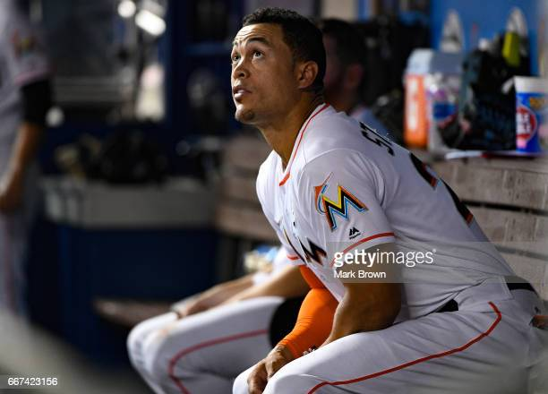 Giancarlo Stanton of the Miami Marlins watches a home run in the fifth inning in the home opener against the Atlanta Braves at Marlins Park on April...