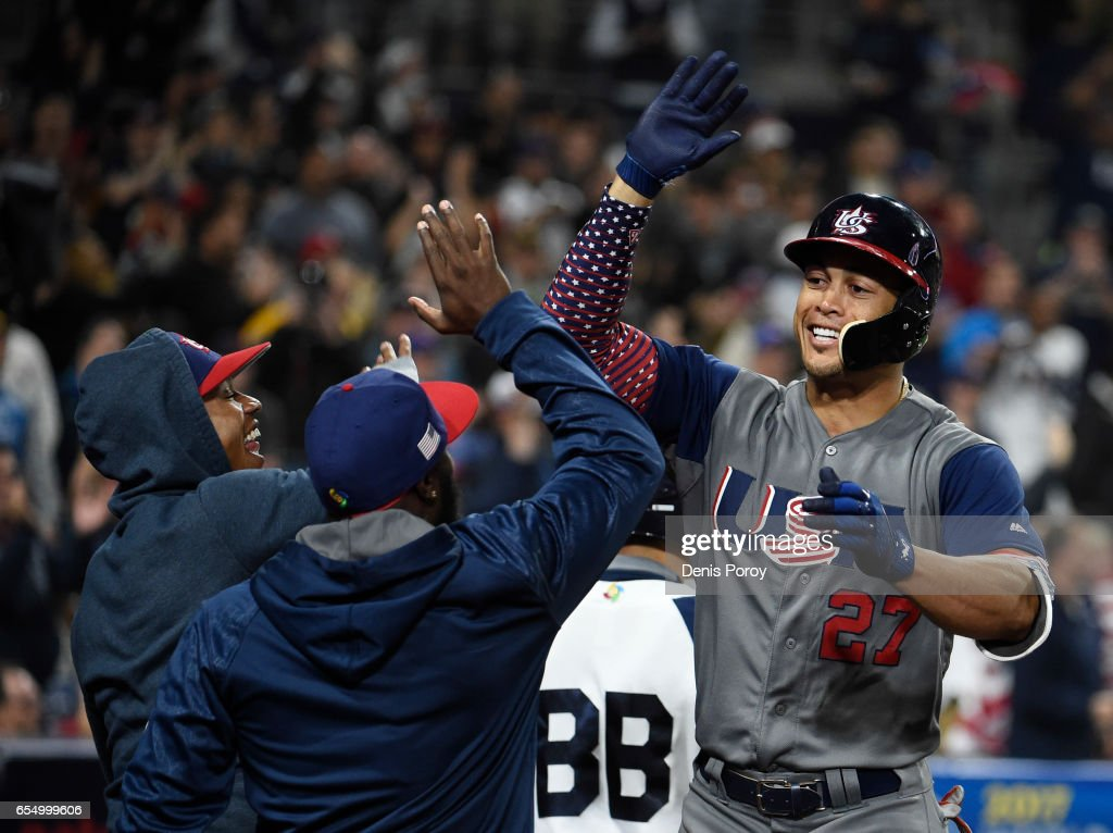 Giancarlo Stanton #27 of the United States, right, is congratulated after hitting a two run home run during the fourth inning of the World Baseball Classic Pool F Game Six between the United States and the Dominican Republic at PETCO Park on March 18, 2017 in San Diego, California.