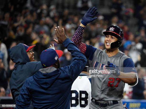 Giancarlo Stanton of the United States right is congratulated after hitting a two run home run during the fourth inning of the World Baseball Classic...