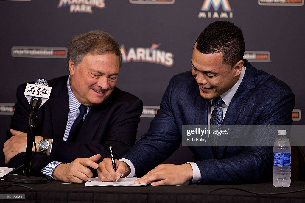 Giancarlo Stanton signs a contract with the Miami Marlins as owner Jeffrey Loria looks on during a press conference at Marlins Park on November 19, 2014 in Miami, Florida.