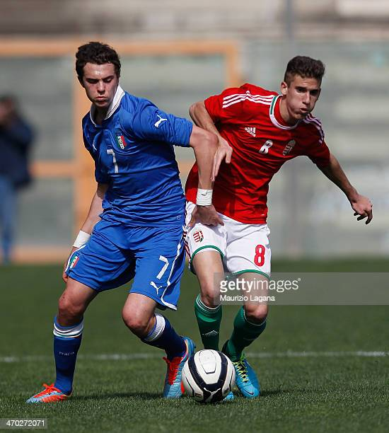 Gianfilippo Felicioli of Italy competes for the ball with Matyas Tajti of Hungary during the international friendly match between Italy U17 and...