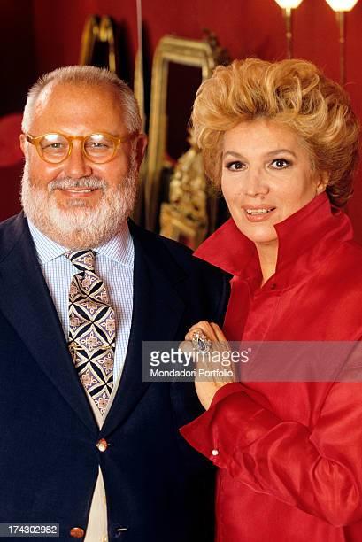 Gianfranco Ferrè smiling and elegant next to Iva Zanicchi