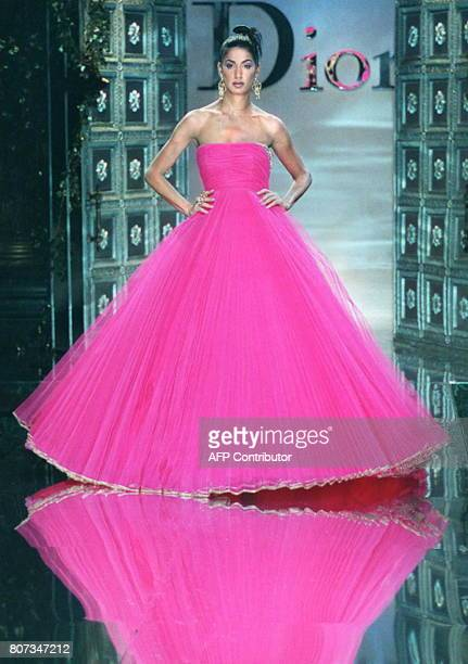 Gianfranco Ferre for Christian Dior shows a pleated fuschia tulle dress with an embroidered silver hem for the autumn/winter 19961997 highfashion...
