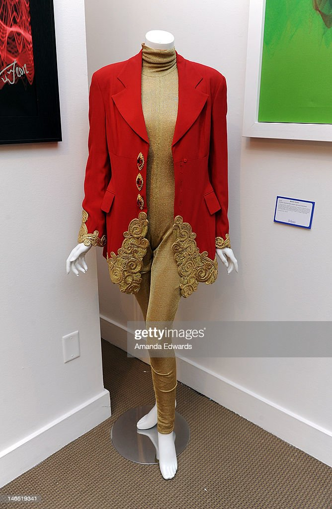 A Gianfranco Ferre red silk jacket and Diane gold knit bodysuit worn by singer Whitney Houston are displayed at the Julien's Auctions press call for Music Icons And Sports Legends Memorabilia Auction at Julien's Auctions Gallery on June 18, 2012 in Beverly Hills, California.