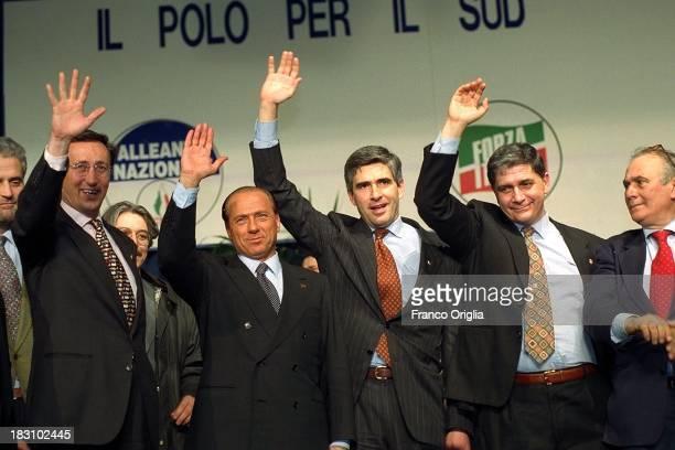 Gianfranco Fini Silvio Berlusconi Pier Ferdinando Casini Rocco Buttiglione and Giuseppe 'Pinuccio' Tatarella attend a centerright coalition rally for...