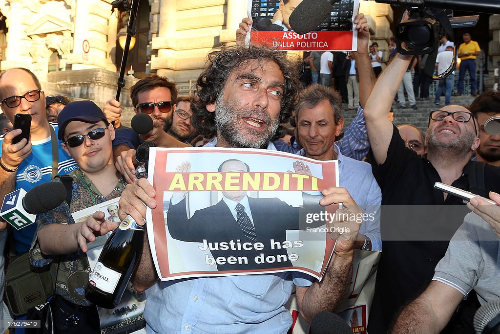 Gianfranco Mascia of 'Popolo Viola' movement reacts in front of the Justice palace to the verdict of the 'Corte di Cassazione' (Supreme Court) during the final session to judge former Italian Prime Minister Silvio Berlusconi on August 1, 2013 in Rome, Italy. The judges of the supreme court rejected Berlusconi's final appeal against the conviction for tax fraud, sentencing him to four years in prison.