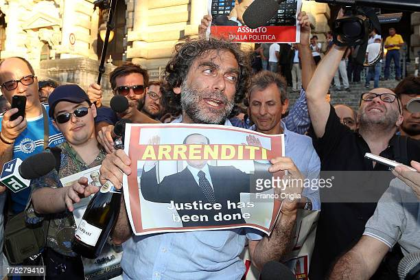 Gianfranco Mascia of 'Popolo Viola' movement reacts in front of the Justice palace to the verdict of the 'Corte di Cassazione' during the final...