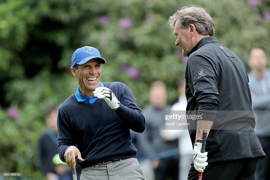 <a gi-track='captionPersonalityLinkClicked' href=/galleries/search?phrase=Gianfranco+Zola&family=editorial&specificpeople=213951 ng-click='$event.stopPropagation()'>Gianfranco Zola</a> and <a gi-track='captionPersonalityLinkClicked' href=/galleries/search?phrase=Glenn+Hoddle&family=editorial&specificpeople=217513 ng-click='$event.stopPropagation()'>Glenn Hoddle</a> react during the Pro-Am prior to the BMW PGA Championship at Wentworth on May 25, 2016 in Virginia Water, England.