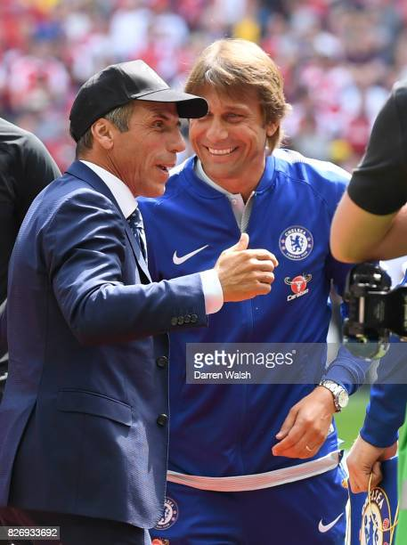 Gianfranco Zola former Chelsea football player and Antonio Conte Manager of Chelsea shake hands prior to the The FA Community Shield final between...