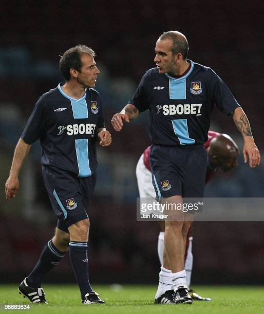 Gianfranco Zola Manager of West Ham United and Paolo Di Canio talk together during the Tony Carr Testimonial match between the Academy AllStars and...