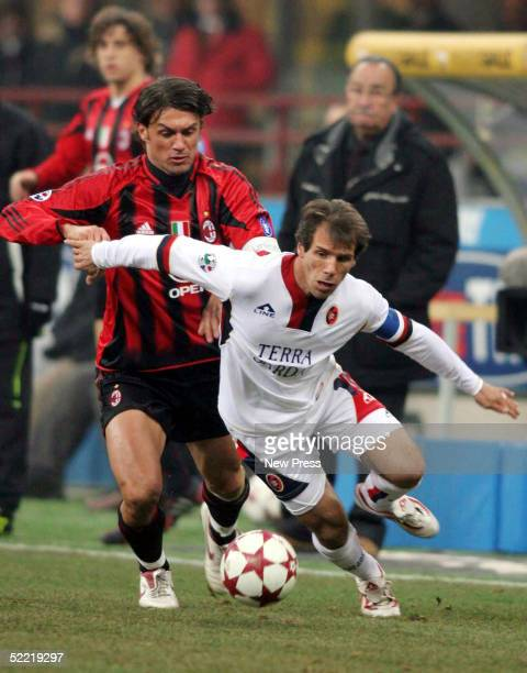 Gianfranco Zola of Milan fights for the ball against Paolo Maldini of Cagliari February 19 2005 at Guiseppe Meazza Stadium in Milan Italy