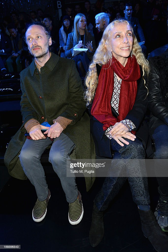 Gianluca Cantaro and <a gi-track='captionPersonalityLinkClicked' href=/galleries/search?phrase=Franca+Sozzani&family=editorial&specificpeople=639425 ng-click='$event.stopPropagation()'>Franca Sozzani</a> attend the Versace show as part of Milan Fashion Week Menswear Autumn/Winter 2013 on January 12, 2013 in Milan, Italy.
