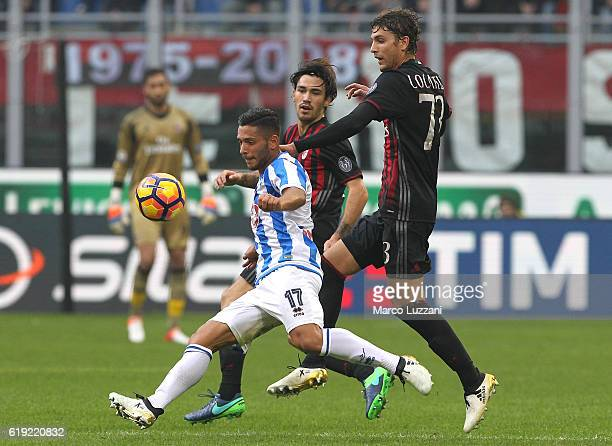 Gianluca Caprari of Pescara Calcio competes for the ball with Manuel Locatelli of AC Milan during the Serie A match between AC Milan and Pescara...