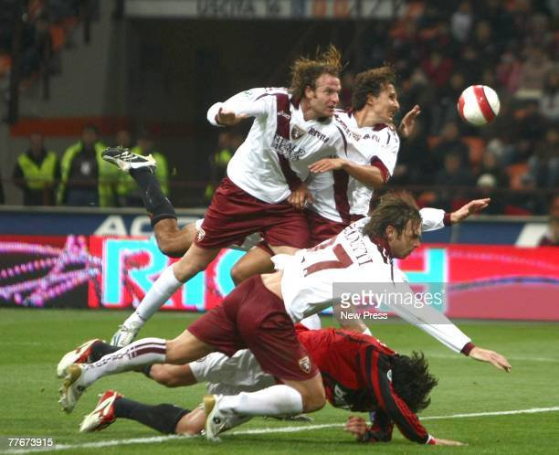 Gianluca Comotto Cesare Natali and Paolo Zanetti of Torino and Kakha Kaladze of Milan in action during the Serie A match between Milan and Torino on...