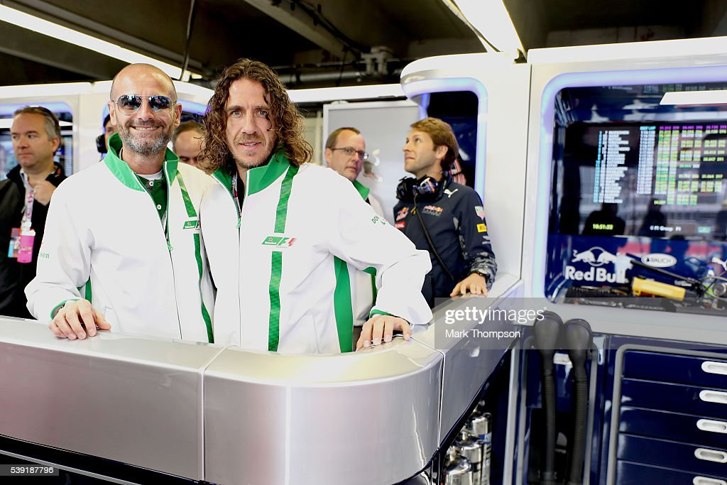 Gianluca Di Tondo, Senior Director Global Heineken Brand and Heineken ambassador Carles Puyol in the Red Bull Racing garage during practice for the Canadian Formula One Grand Prix at Circuit Gilles Villeneuve on June 9, 2016 in Montreal, Canada.