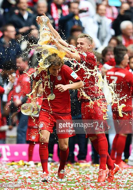 Gianluca Gaudino of Bayern Muenchen and Sinan Kurt of Bayern Muenchen celebrate after winning the league during the Bundesliga match between FC...