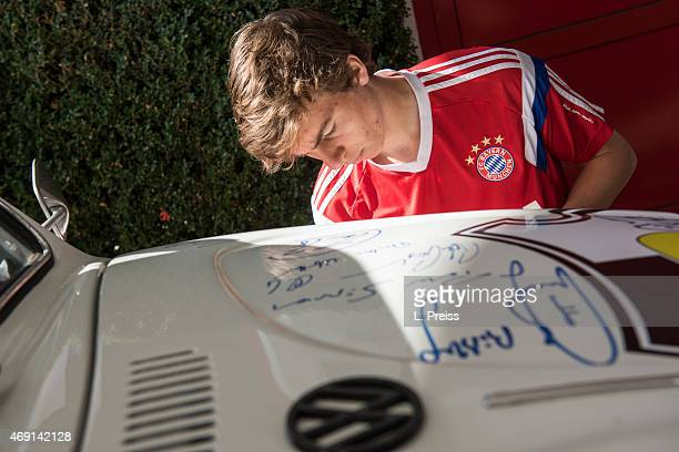 Gianluca Gaudino of FC Bayern Muenchen signs a Volkswagen Beetle car for Borussia Neunkirchen on April 10 2015 in Munich Germany The VW Beetle from...