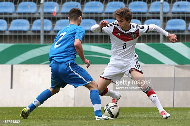 Gianluca Gaudino of Germany challenges Andrej Kadlec of Slovakia during the UEFA Under19 Elite Round match between U19 Germany and U19 Slovakia at...