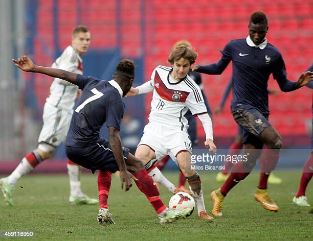 Gianluca Gaudino of Germany competes with of Maxwel Gnaly Cornet of France during the UEFA U19 Friendly Tournament match between France vs Germany at...