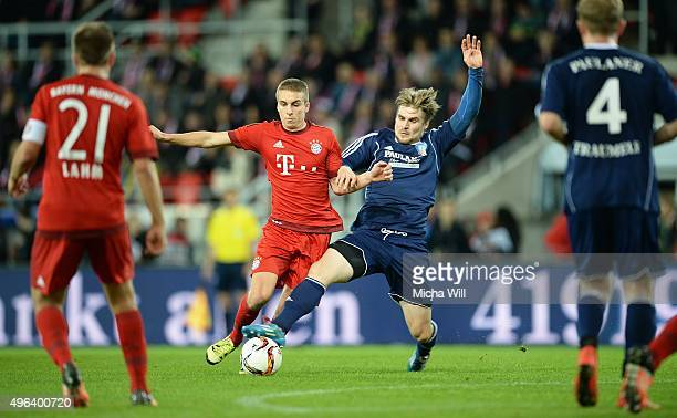 Gianluca Gaudino of Muenchen and Masshitas Fischer of Paulaner Traumelf compete for the ball during the friendly match between FC Bayern Muenchen and...