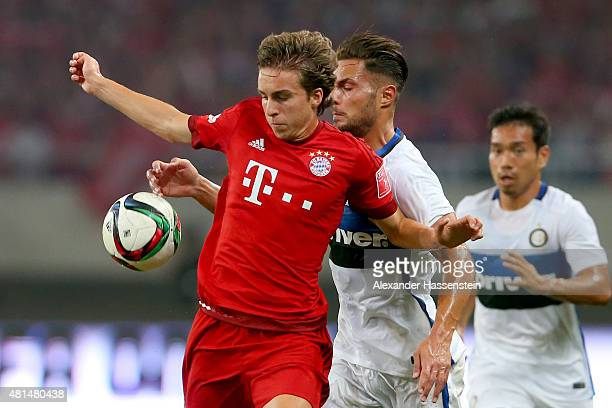 Gianluca Gaudino of Muenchen battles for the ball with Danilo D'Ambrosio of Milan during the international friendly match between FC Bayern Muenchen...