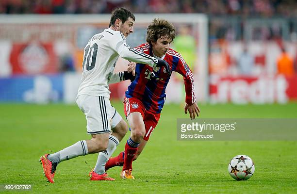 Gianluca Gaudino of Muenchen is challenged by Alan Dzagoev of Moskva during the UEFA Champions League Group E match between FC Bayern Muenchen and...