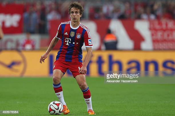 Gianluca Gaudino of Muenchen runs with the ball during the Bundesliga match between FC Bayern Muenchen and VfL Wolfsburg at Allianz Arena on August...