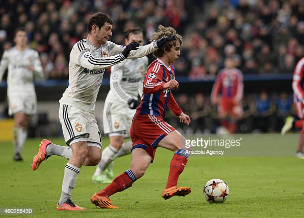 Gianluca Gaudino of Munich and Alan Dzagoev of CSKA Moscow fight for the ball during the Champions League soccer match between FC Bayern Munich and...